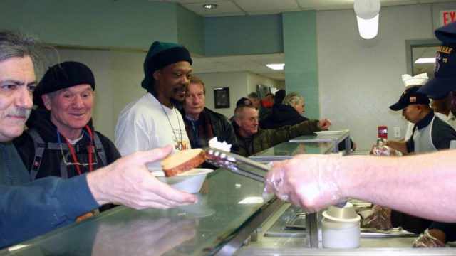 070202-N-8110K-044 Boston (Feb. 2, 2007) Ð Sailors assigned to guided missile destroyer USS Mahan (DDG 72) serve lunch to homeless veterans at the New England Shelter for Homeless Veterans. The community service project is just one of several planned events for the Sailors during their brief port visit to Boston. Mahan, assigned to Standing NATO Maritime Group One, are spending a few days in the New England port city before resuming a NATO joint operational training mission. U.S. Navy photo by Chief Mass Communication Specialist Dave Kaylor (RELEASED)