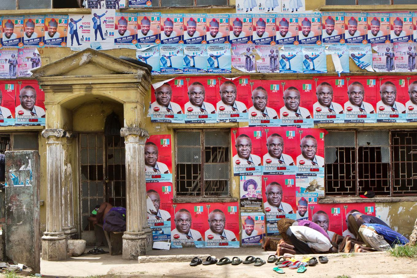 Prayer and political posters in the ebute metta neighborhood on the mainland photo by andrew esiebo