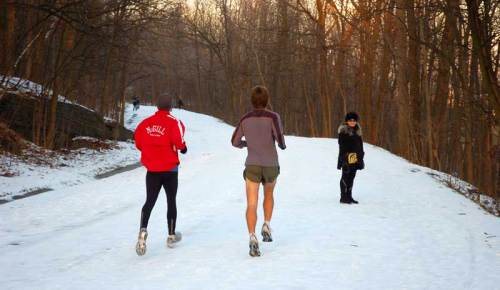 Joggers enjoy spring conditions on the roads and paths near Beaver Lake on Mont-Royal