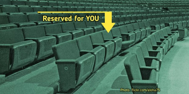 Photo of an auditorium, with a seat labeled Reserved For You