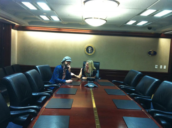 Rob Zombie and Sheri Moon Zombie sitting in the White House situation room
