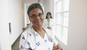 African American nurse in hospital hallway