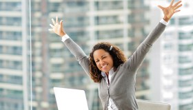 Successful African American businesswoman celebrating her succes.