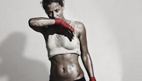 Female Boxer wiping off the sweat from her face