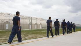 Detainees walk the line inside Homeland...