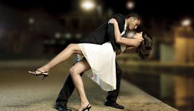 Attractive Couple Dancing at Night