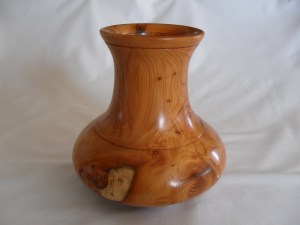 Turned Yew wood vase with glass insert and using polish as a finish