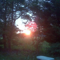 Gods World is awesome I am watching the sun rise by the fire IMG01377