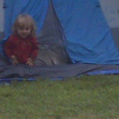 Samuel coming out of the tent from his first campout