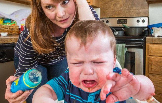 woman-feeds-gumpy-baby