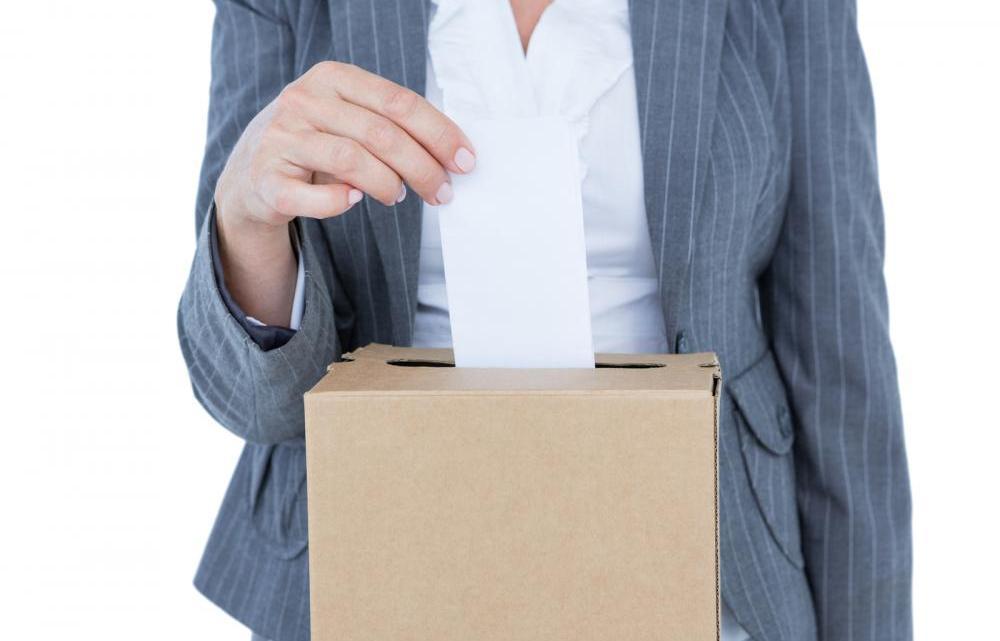 businessman-putting-ballot-in-vote-box
