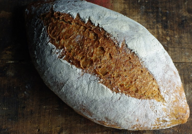 A rustic flour covered, oblong loaf.