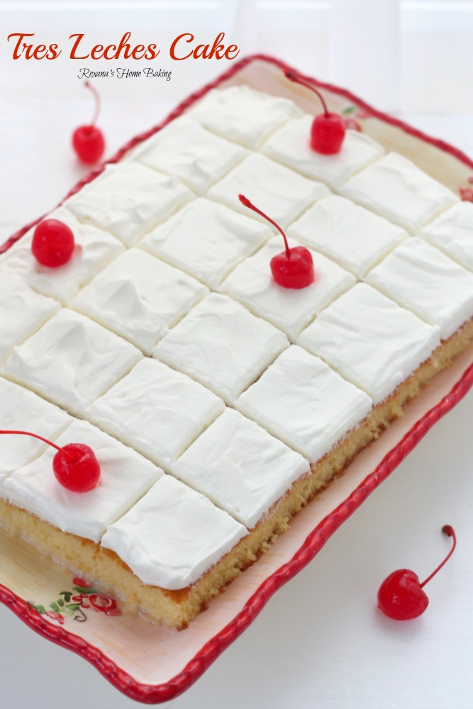 Tres leches cake from Roxanashomebaking.com Sweet and spongy cake soaked in three milks (evaporated milk, condensed milk and half and half) and topped with sweetened whipped cream