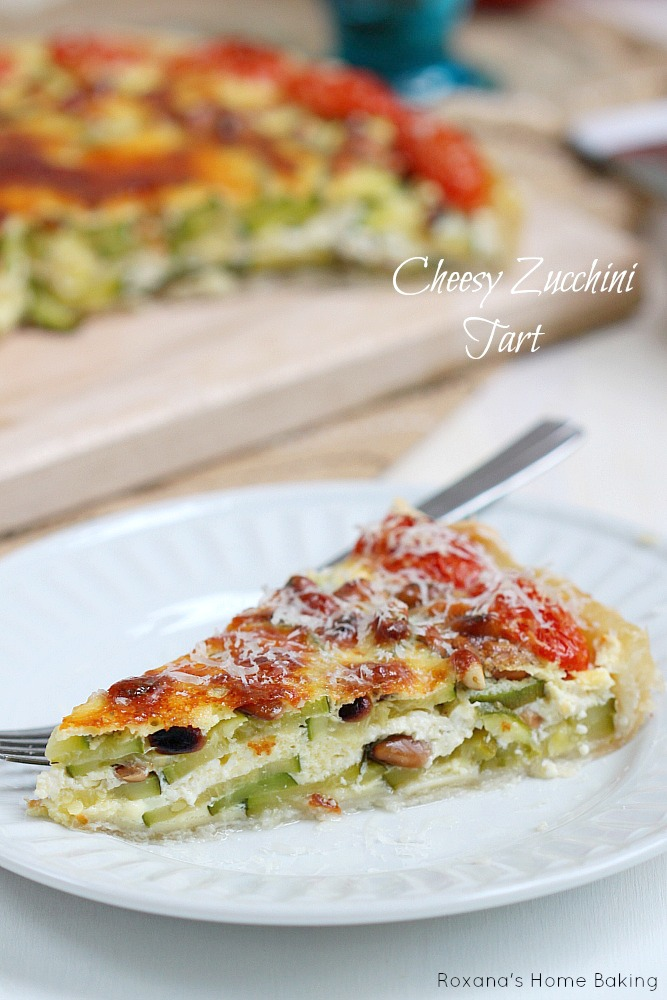 Cheesy zucchini tart - a crowd pleaser may it be at your next picnic, potluck or just family dinner. Recipe from Roxanashomebaking.com