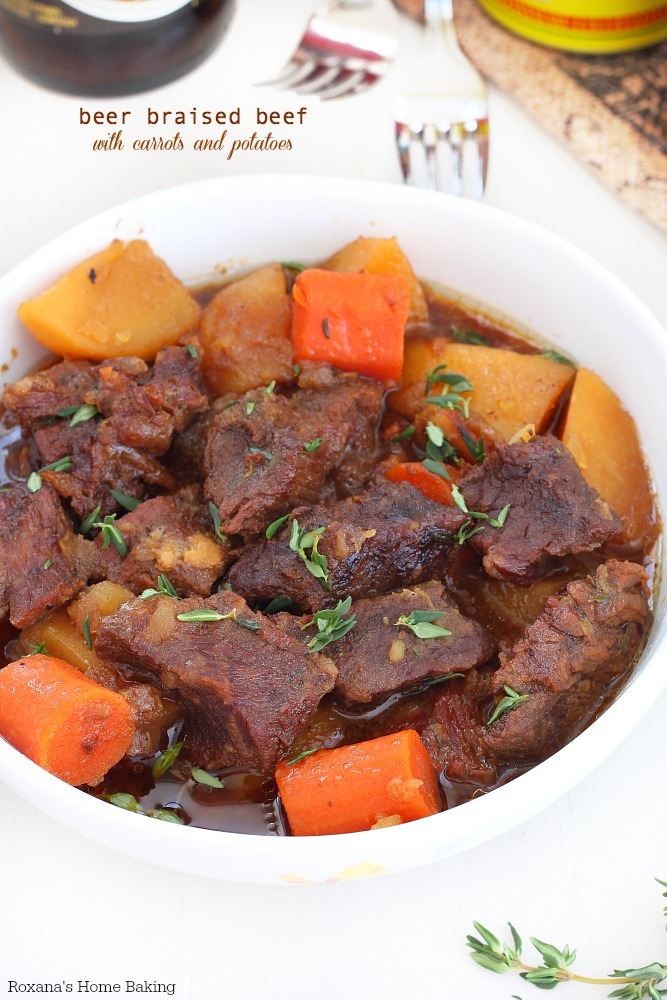 Flavorful beer braised beef with carrots and potatoes, cooked slow and ...