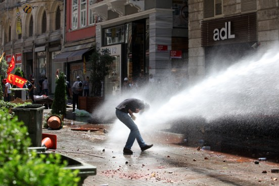 Police use a water cannon to disperse protestors near the Taksim Gezi park in Istanbul after clashes with riot police, on June 1, 2013, during a demonstration against the demolition of the park (AFP Photo / Gurcan Ozturk)