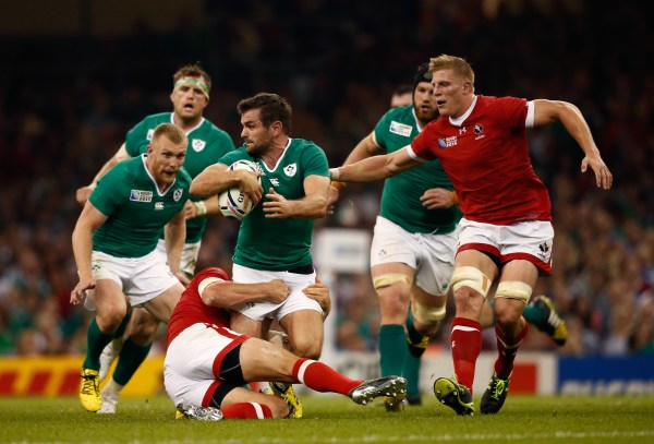 CARDIFF, WALES - SEPTEMBER 19: Jared Payne of Ireland tries to offload to Keith Earls of Ireland during the 2015 Rugby World Cup Pool D match between Ireland and Canada at the Millennium Stadium on September 19, 2015 in Cardiff, United Kingdom. (Photo by Stu Forster/Getty Images)
