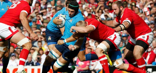 Italy's Francesco Minto is tackled by the Canada defence during the Rugby World Cup Pool D match between Italy and Canada at Elland Road, Leeds, England, Saturday, Sept. 26, 2015. (AP Photo/Alastair Grant)