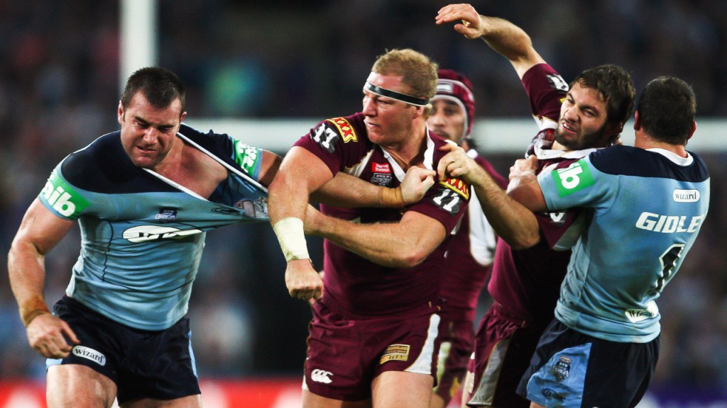 SYDNEY, AUSTRALIA - JUNE 24:  Justin Poore of the Blues and Michael Crocker of the Maroons throw punches during game two of the ARL State of Origin series between the New South Wales Blues and the Queensland Maroons at ANZ Stadium on June 24, 2009 in Sydney, Australia.  (Photo by Mark Kolbe/Getty Images) *** Local Caption *** Justin Poore;Michael Crocker