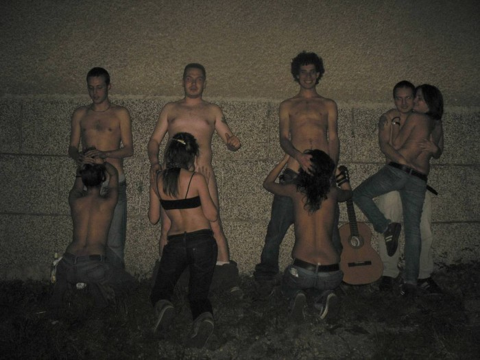 Nude drunken group of young people having fun