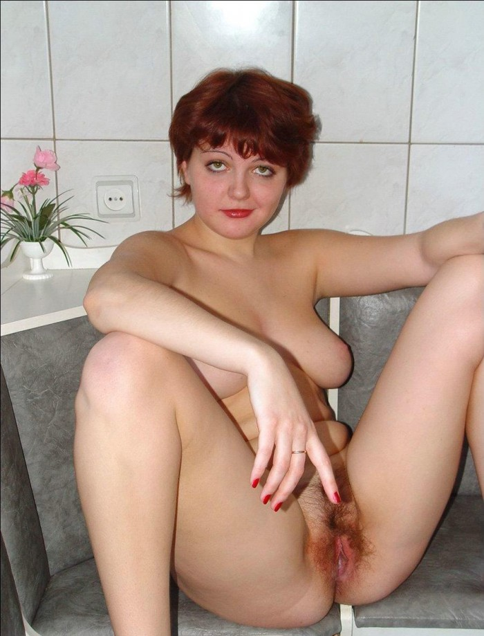 Fat mature redhead with hairy pussy