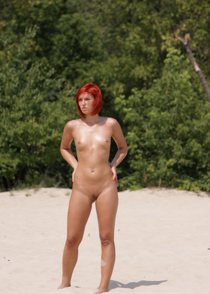 Redhead with small tits on the beach