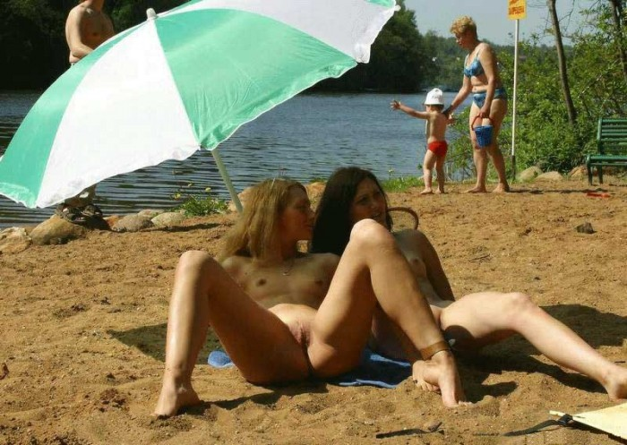 Group of naked teen plays on the beach