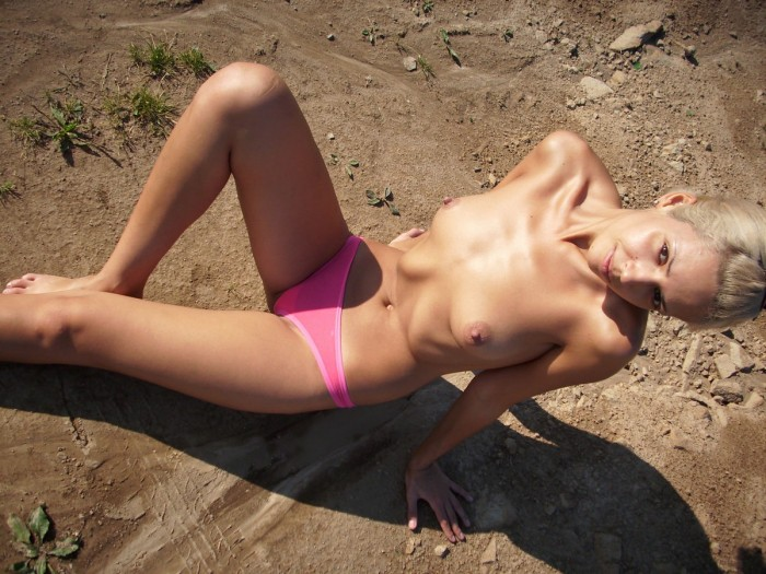 Little skinny blonde girl posing outdoors