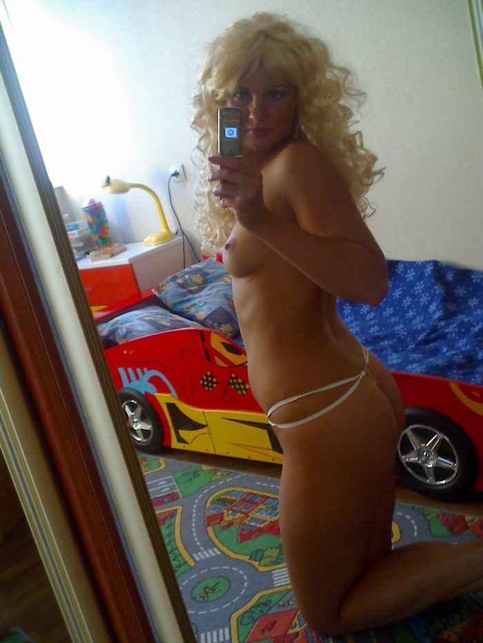 Russian curly blonde topless milf in the mirror