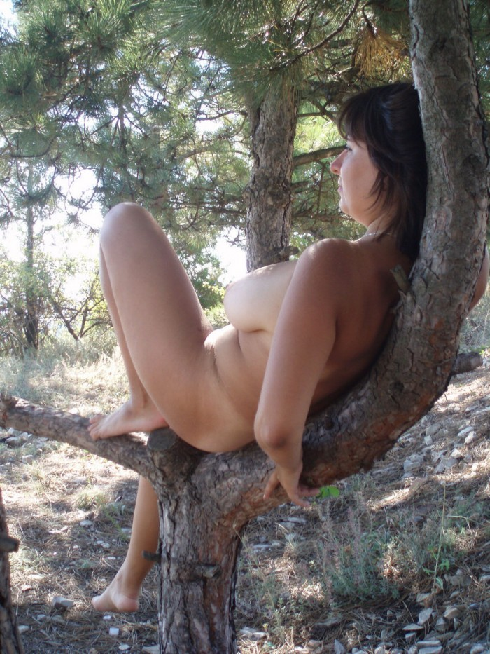 Big mature wife with big boobs posing outdoors