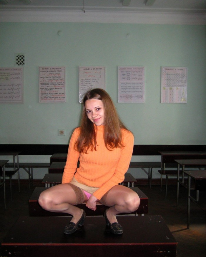 Lovely russian teen girl undressing in classroom