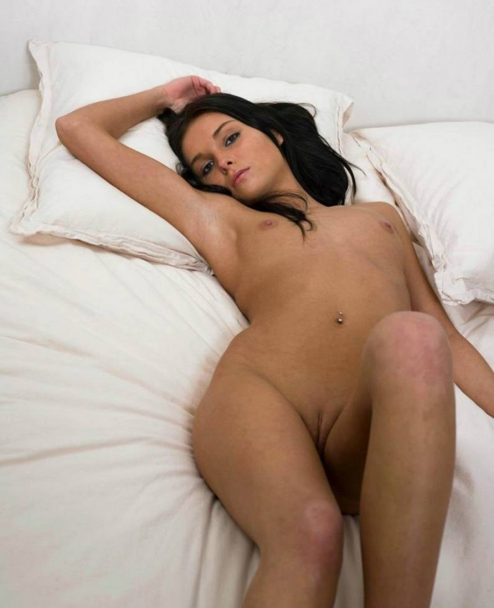 Beautiful skinny brunette with amazing body at home