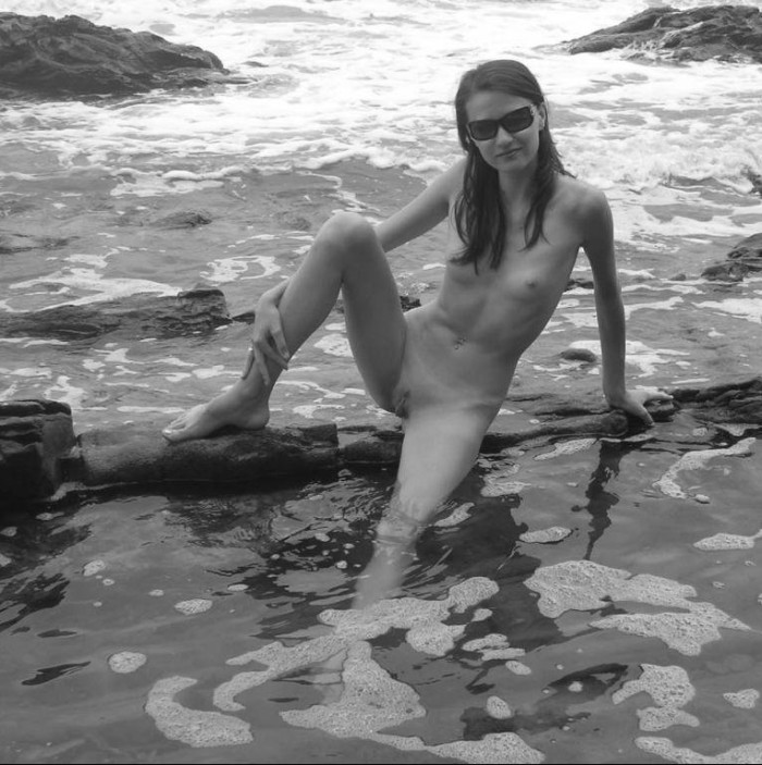 Skinny and nasty Russian harlot is sitting naked on the hot beach
