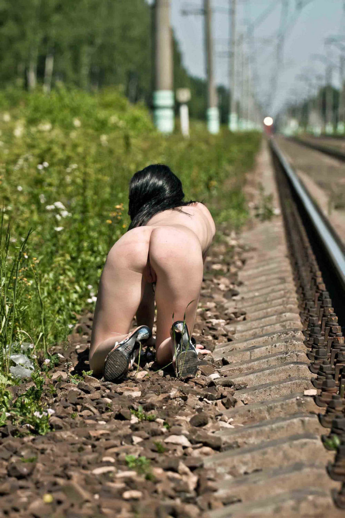 Teen brunette posing naked on railroad