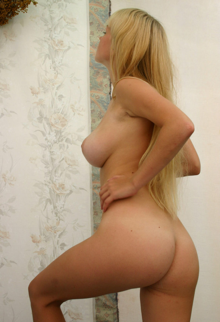 Amazing blonde with very big boobs