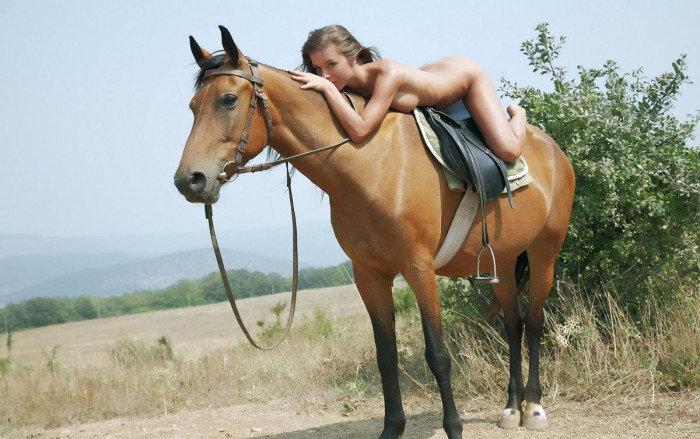 Beautiful girl with very big pussy on horse