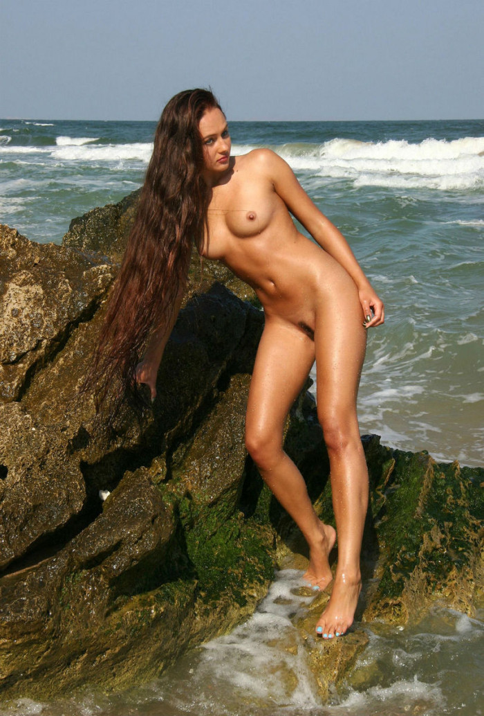 Girl With Very Long Hair And Tanned Body In The Sea S