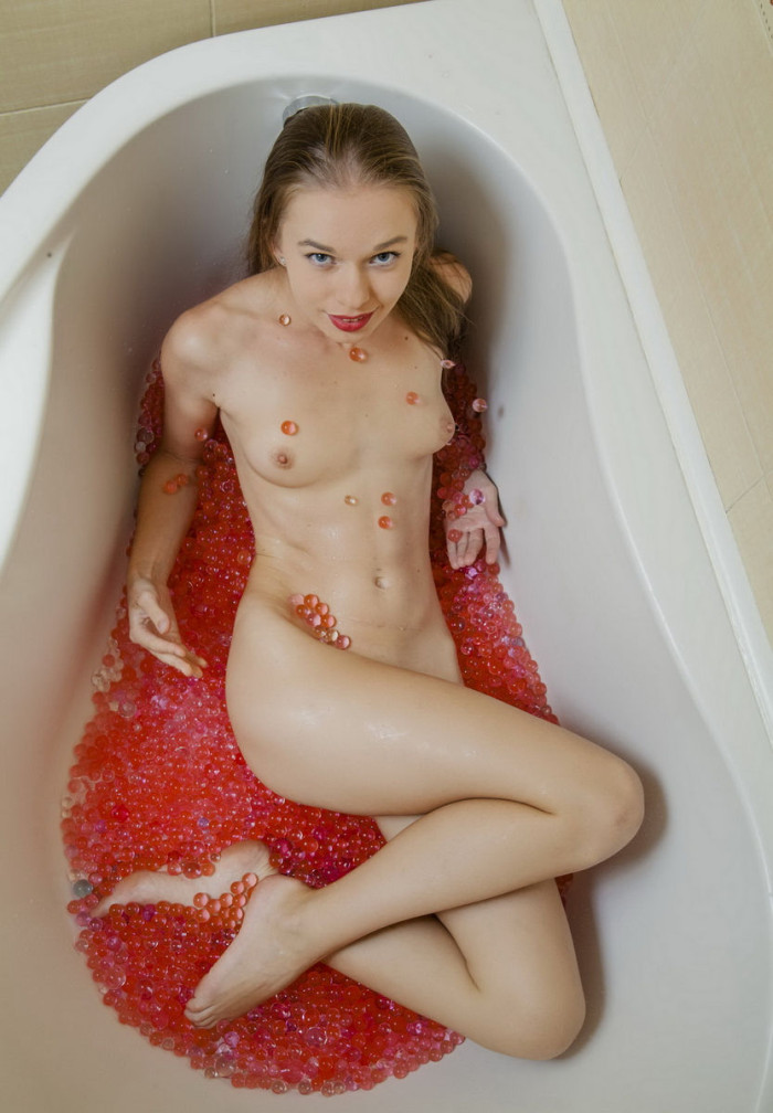 Skinny girl shows off all her holes in the bath