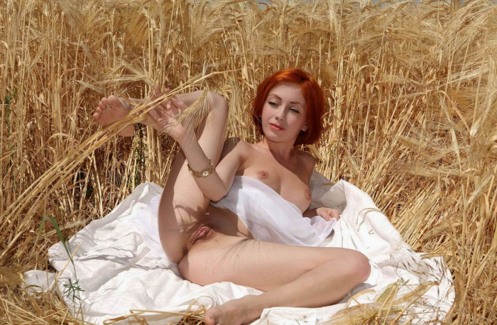 Red haired beauty with big pussy lips in a wheat field