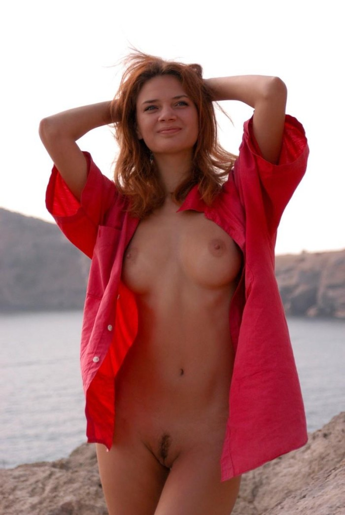 Red haired girl with big tits at the sea