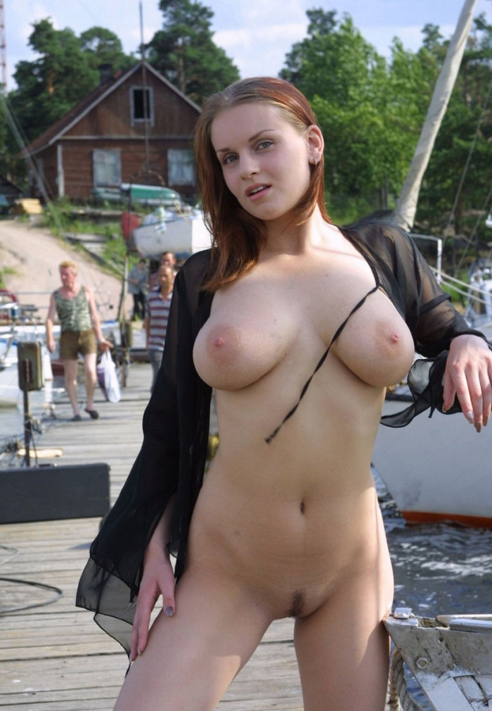 Very busty russian girl posing at public pier