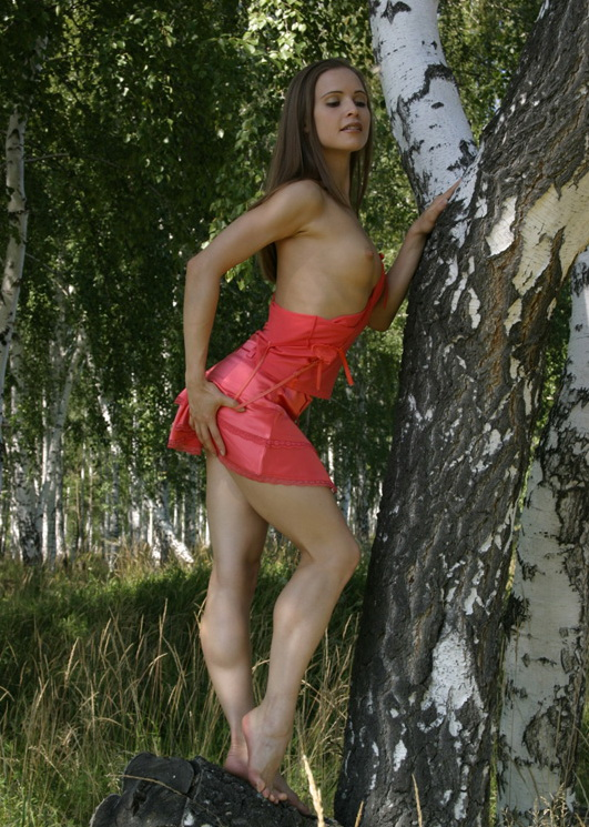 Athletic girl with a pink skirt shows her sweet pussy in the woods
