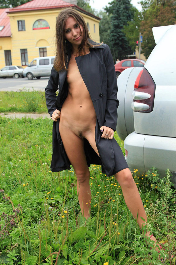 Beautiful girl with very small tits flashes at public streets