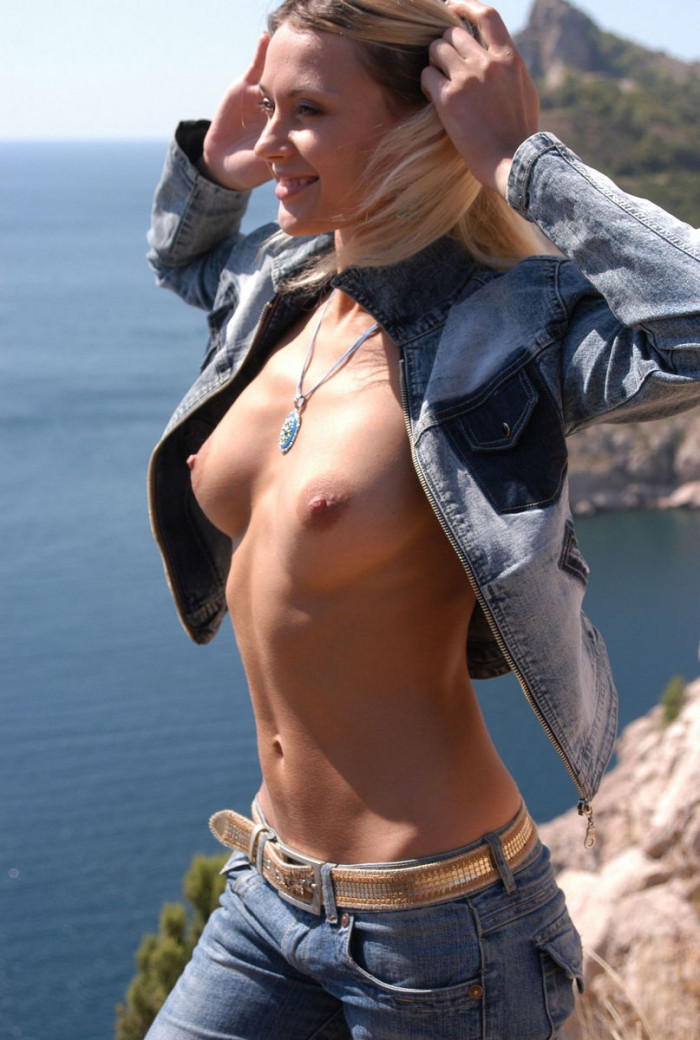 Blonde with lovely soft boobs on the rocks