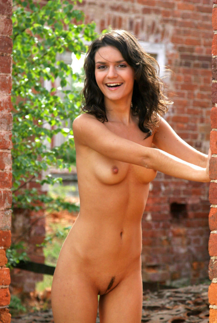 Sporty brunette posing naked in abandoned building
