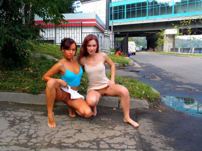 Two redhead lesbians at public park in Moscow