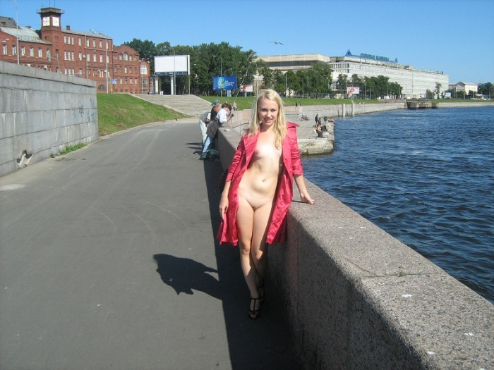 Blonde with small tits flashes at public quay