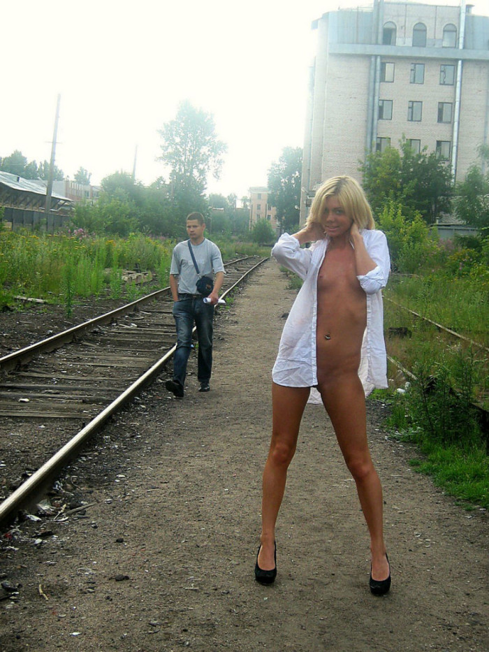 Blonde with small tits posing with old man stranger on railroad