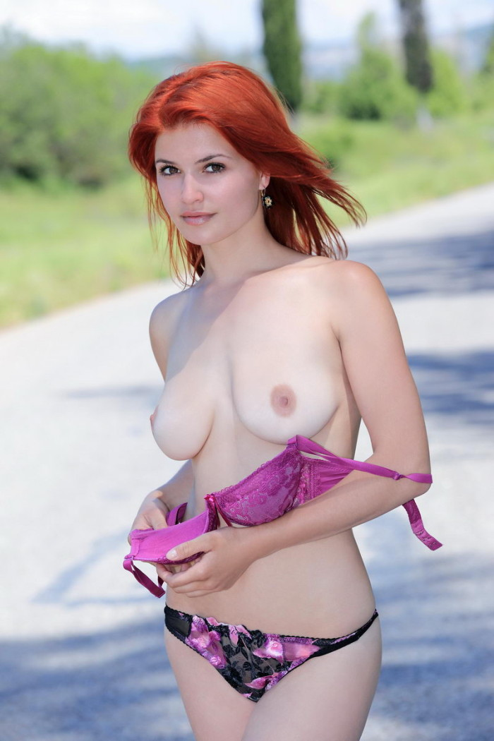 Busty Violla A posing naked outdoors