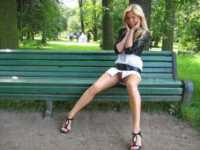 Sarah C with beautiful legs walks without panties in short skirt